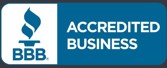 The seal of accrediation from the Better Business Bureau for Strategos Solutions. It is a blue image with white text on a gun-metal grey background.
